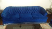 Blue couch and 2 tub chairs